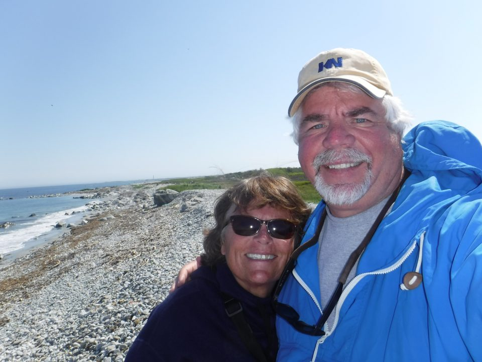 Selfie of Chris Budeski and woman by the beach